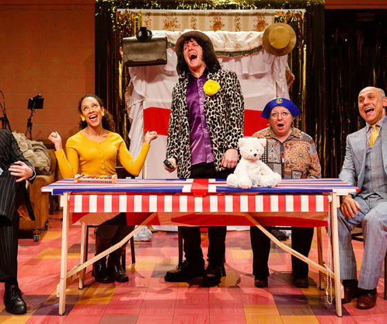 The cast of Monster Raving Loony around a table at an electoral hustings.