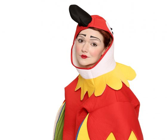 A woman in a parrot costume looks ahead, noncommittal