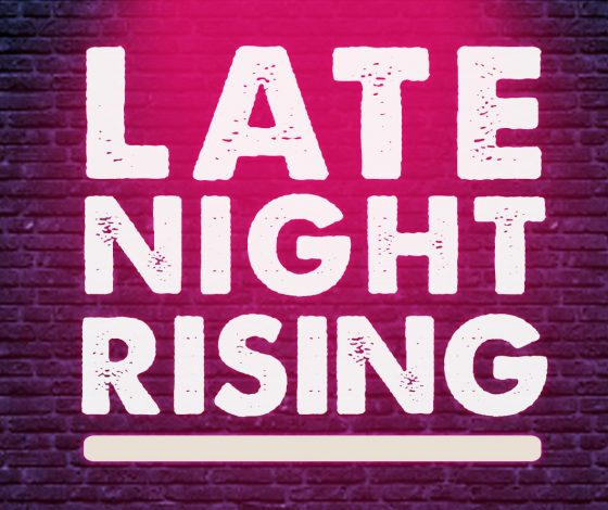 A neon 'Late Night Rising' sign on a brick wall