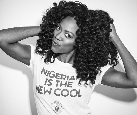 """Woman in white t-shirt, reading """"NIGERIA IS THE NEW COOL"""""""