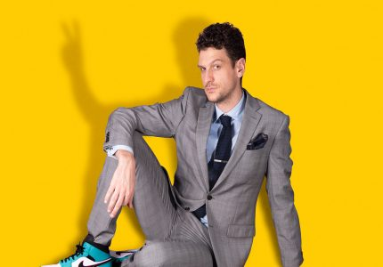 publicity image of Steen Raskopoulos for the comedy show Business.Never.Stops.