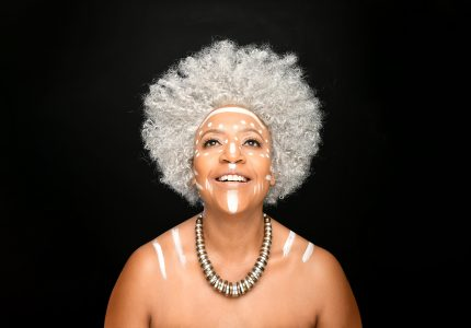 publicity image of Njambi McGrath for the comedy show Accidental Coconut