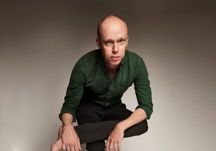 publicity image of Jordan Brookes for the comedy show Jordan Brookes: Work in Progress