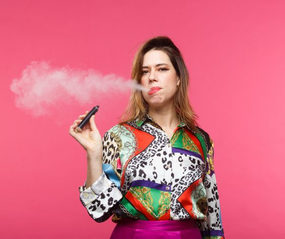 publicity image of Lou Sanders for the comedy show Lou Sanders: Work in Progress